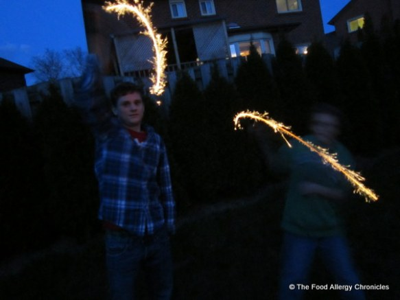 Boys outside with sparklers