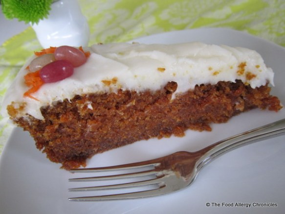 A slice of Dairy, Egg and Peanut/Tree Nut Free Carrot Cake with Dairy Free 'Cream Cheese' Icing