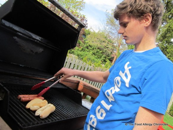 Michael bbqing his hotdogs for a snack