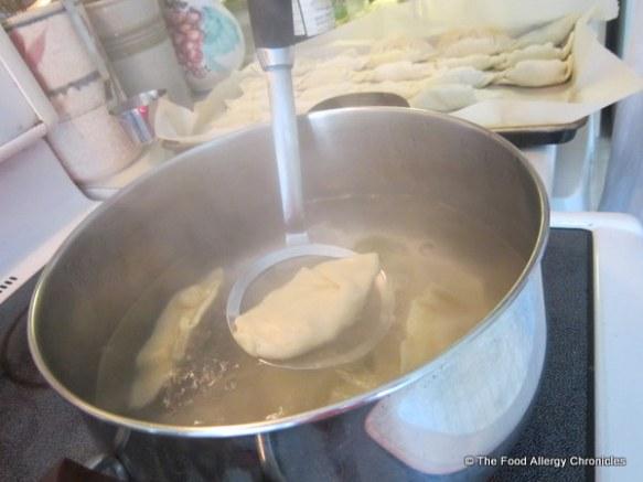 Matthew boiling the Chinese Dumplings