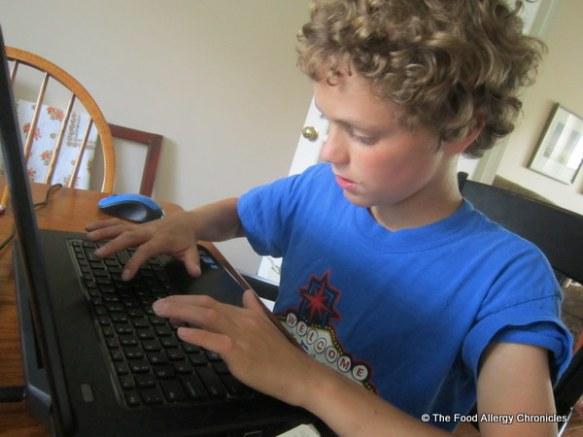 Matthew writing his story on Chinese Dumplings