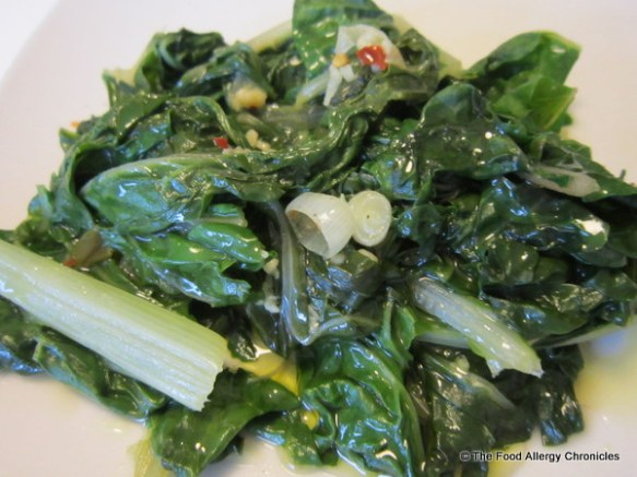 Swiss Chard with onions, garlic and hot pepper flakes drizzled with extra virgin olive oil