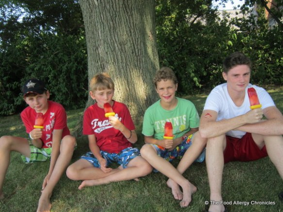 Boys enjoying Dairy and Peanut/Tree Nut Free Strawberry Lemonade Popsicles on Canada Day