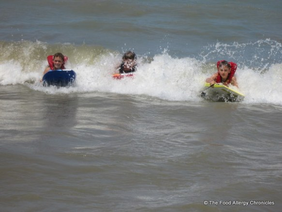 Boys riding the waves