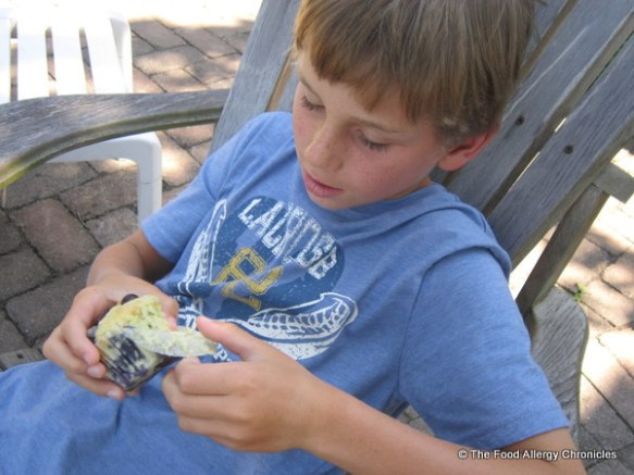 My nephew, eager to try a Dairy, Egg, Soy and Peanut/Tree Nut Free Lemon Blueberry Zucchini Muffin