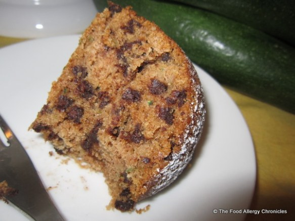 Enjoying a slice of Dairy, Egg, Soy and Peanut/Tree Nut Free Chocolate Chip Zucchini Bundt Cake