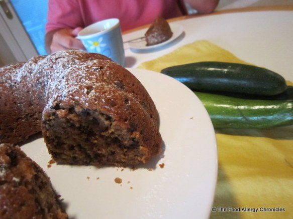 My husband enjoying a piece of Dairy, Egg, Soy and Peanut/Tree Nut Free Chocolate Chip Zucchini Bundt Cake