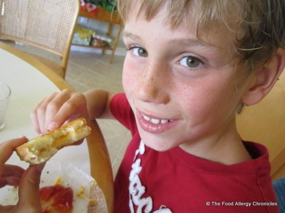 My youngest nephew enjoying a Daiya Cheddar Style Shred Grilled Sandwich