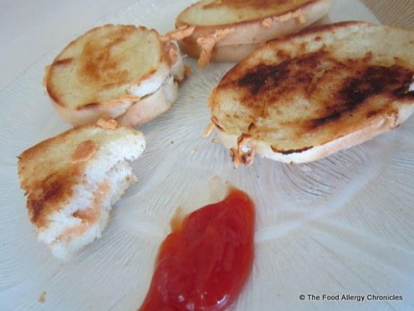 Enjoying Daiya Cheddar Style Shred Sandwiches with ketchup