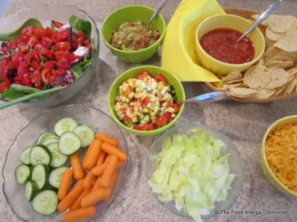 Toppings for Barbequed Chicken Fajitas, side salad, carrots and cucumber slices
