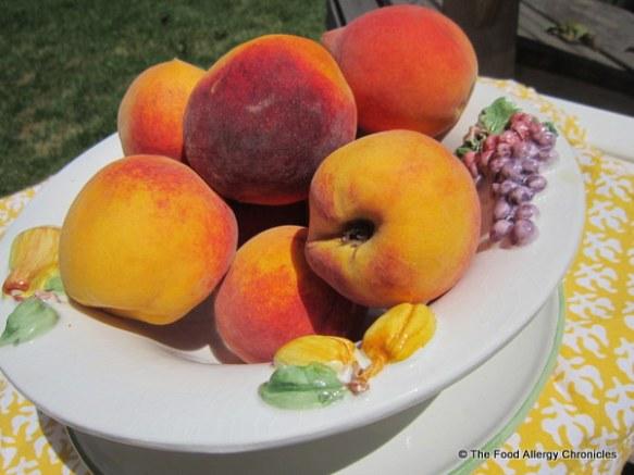 Bowl full of fresh summer peaches