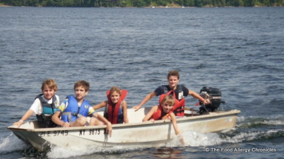 Michael taking the boys out for a ride on the little motor boat