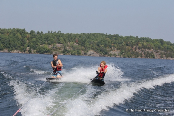 Michael and Matthew knee boarding at their Uncle's cottage