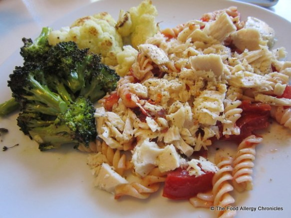Bruschetta Pasta topped with tuna and a side or roasted brocolli and cauliflower