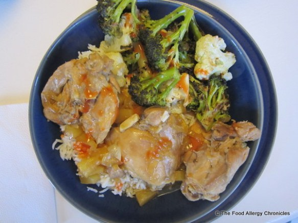 Andy's plate of Chicken Adobo, rice and roasted brocolli and cauliflower doused in hot sauce