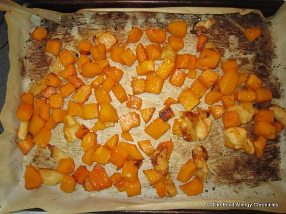 Maple roasted butternut squash and apple on baking sheet