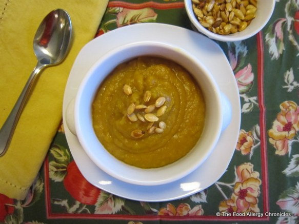 Dairy Free Maple Roasted Butternut Squash and Apple Soup garnished with roasted squash seeds