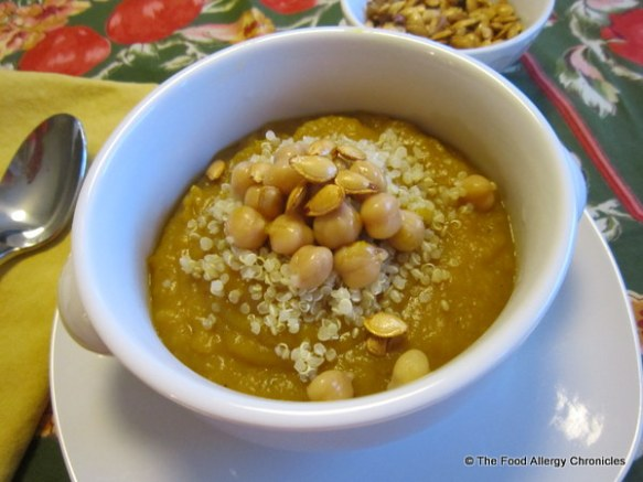 Dairy Free Maple Roasted Butternut Squash and Apple Soup garnished with quinoa, chickpeas and roasted squash seeds