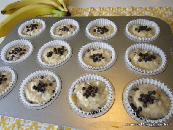 Muffin tin filled with the batter of Dairy, Egg, Soy and Peanut/Tree Nut Free Chocolate Chip Banana Muffins