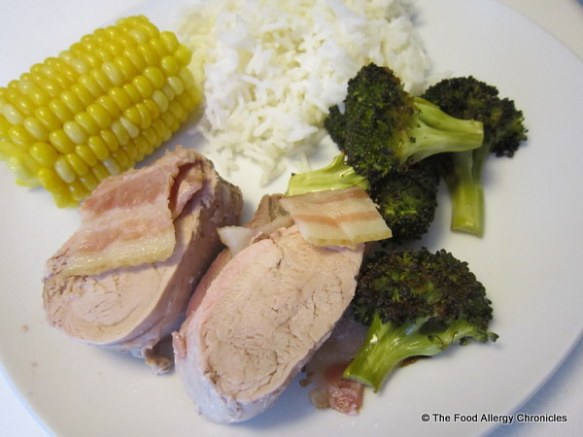Michael's plate of Pork Tenderloin Wrapped in Bacon with rice, roasted brocolli and corn on the cob