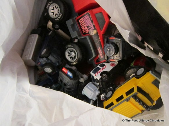 A bag of toy trucks and toys