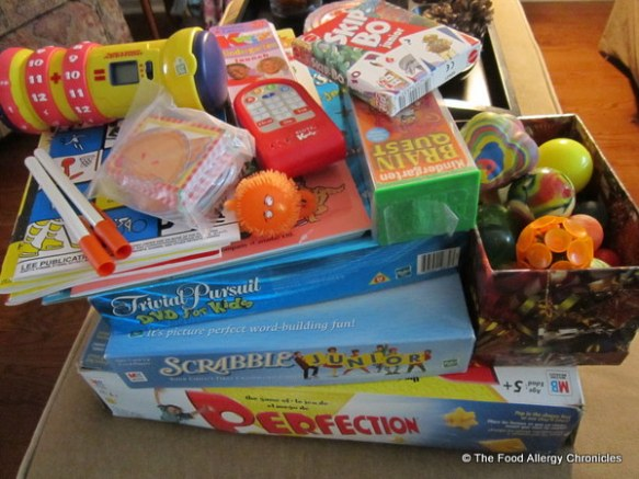 An assortment of games, educational toys and super balls