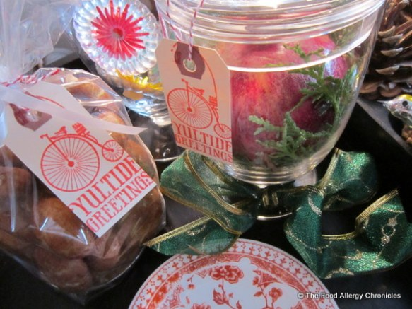 Hostess gifts: Package of Dairy, Egg and Peanut/Tree Nut Free Diwali Chai Snickerdoodle Cookies and Glass Urn with Pomegrante and Greenery
