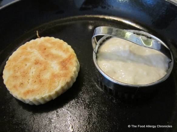 Cooking Dairy, Soy and Peanut/Tree Nut Free Crumpets in a cast iron pan