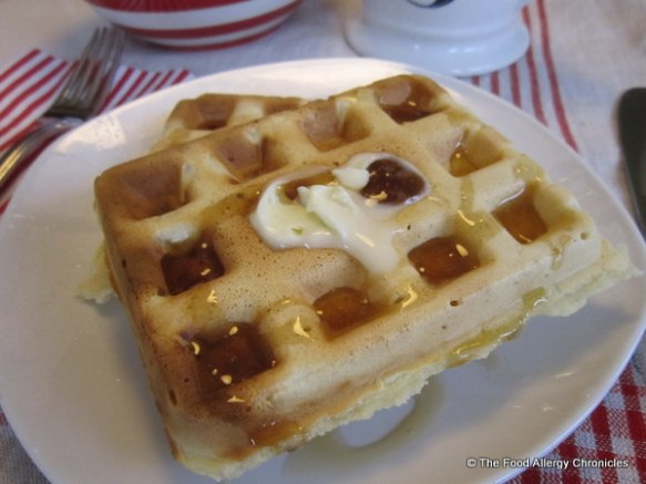 A couple of Dairy, Egg, Soy and Peanut/Tree Nut Free Waffles topped with Vegan Becel Margarine and pure maple syrup