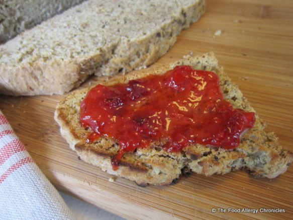 Toasted Dairy, Egg, Soy and Peanut/Tree Nut Free Hearty Irish Soda Bread spread with homemade strawberry jam
