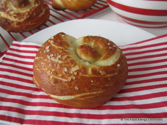 A Dairy, Egg, Soy and Peanut/Tree Nut Free Pretzel Knot Bun ready to eat