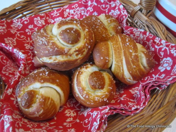 A basket of Dairy, Egg, Soy and Peanut/Tree Nut Free Pretzel Knot Buns