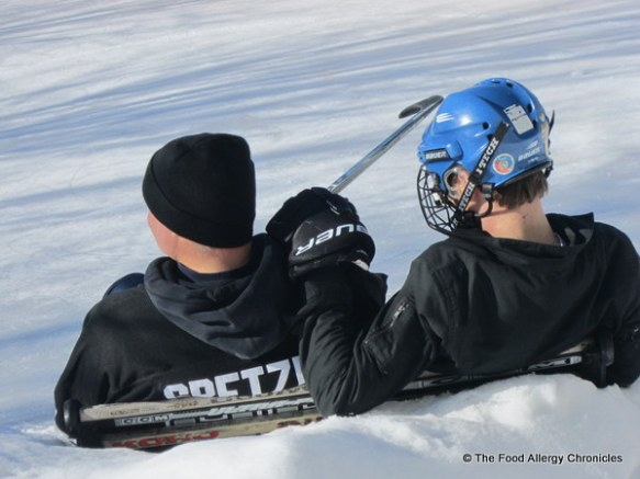 Father and son moment out on thebackyard rink