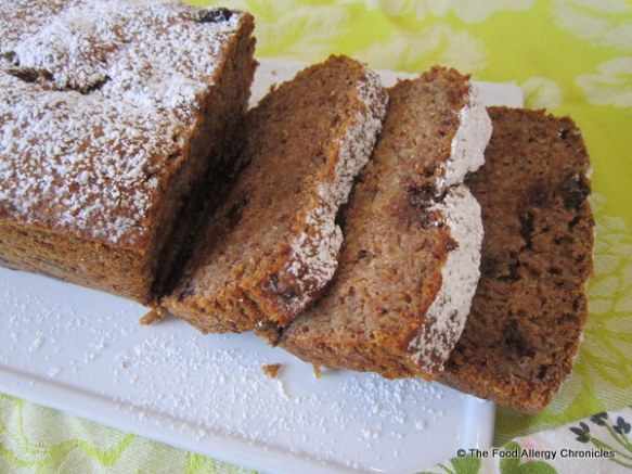 Sliced Dairy, Egg, Soy and Peanut/Tree Nut Free Chocolae Chunk Wholewheat Banana Bread sprinkled with icing sugar