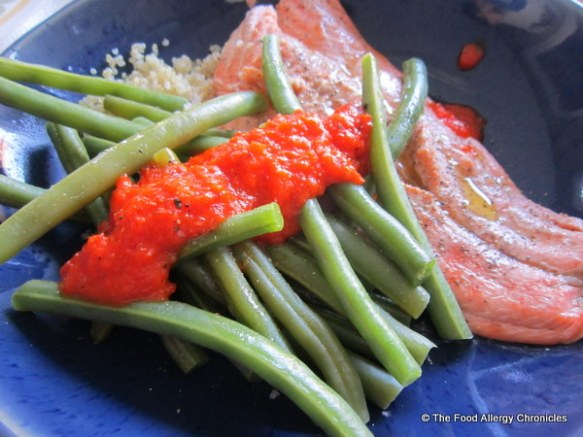 Reserved Roasted Red Pepper Sauce served over green beans