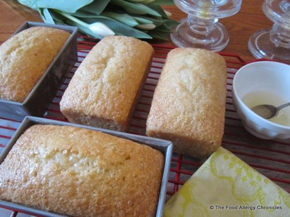 Dairy, Egg, Soy and Peanut/Tree Nut Free Mini Lemon Loaves cooling with sugar glaze