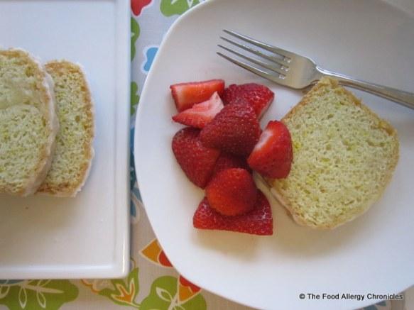 Enjoying a slice of Dairy, Egg, Soy and Peanut/Tree Nut Free Mini Lemon Bread with fresh strawberries
