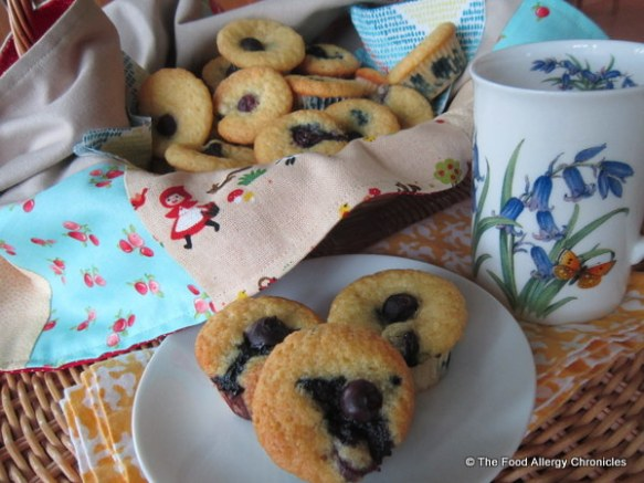 Enjoying Dairy, Egg, Soy and Peanut/Tree Nut Free Lemon Blueberry Cornmeal Mini Muffins with a cup of tea