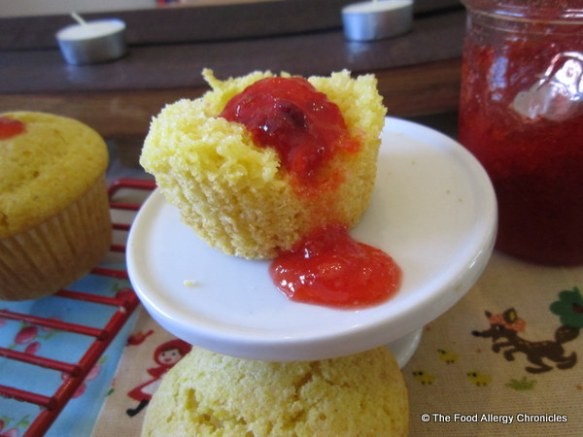 Enjoying a Eairy, Egg, Soy and Peanut/Tree Nut Free Lemon Cornmeal Muffins with a dollop of homemade strawberry jam