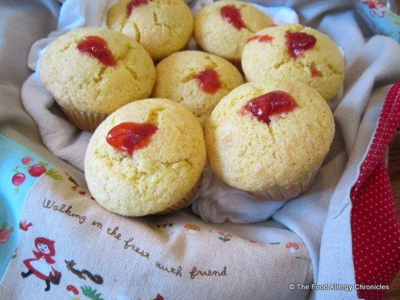 A basket full of Dairy, Egg, Soy and Peanut/Tree Nut Free Homemade Strawberry Jam Filled Lemon Cornmeal Muffins
