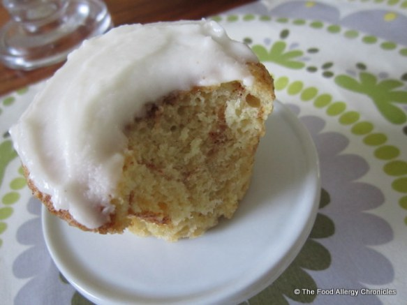 Enjoying a Dairy, Egg, Soy and Peanut/Tree Nut Free Brown Sugar Cinnamon Muffin/Cupcake topped with Dairy Free Vanillla Icing